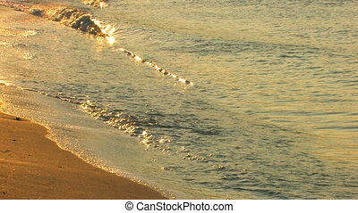 Gold waves on a sandy beach in sunrise, closeup, Canon XH...