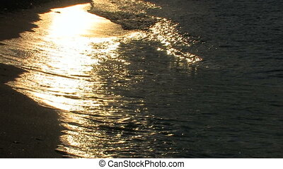 Gold waves on a sandy beach in sun