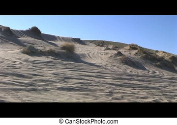 atv in sand dunes - atv racing up sand dune