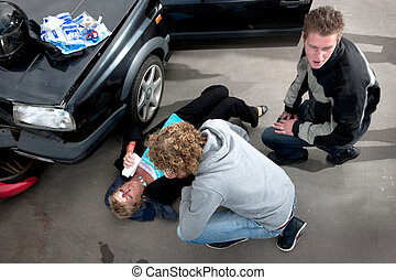First aid - Bystander providing first aid to an injured...
