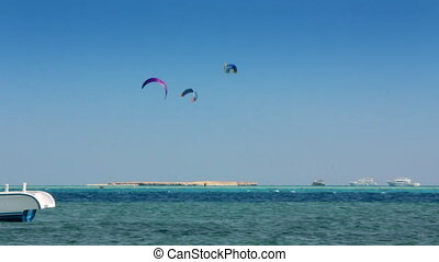 kite surfing - surfers on blue sea surface - timelapse