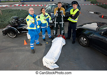 EMS Team - Emergency Medical Services team posing over an...