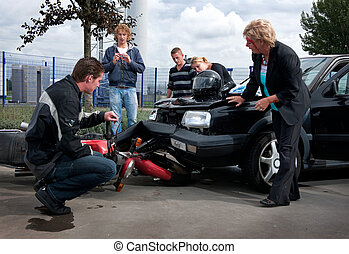 Bodywork damage - People examining the exterior damage to...