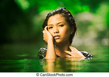Outdoor beauty - Beautiful Asian girl rises up out of stream