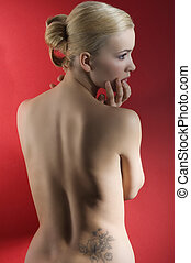blond woman over red - fashion elegant shot of blond naked...