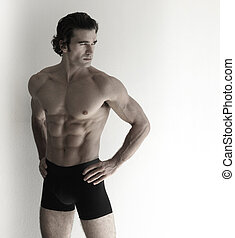 Fitness model - Fashion portrait of sexy male fitness model...