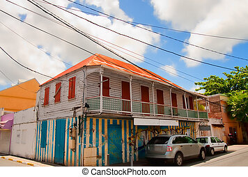 Cars Along Colorful Old Building in Tropics