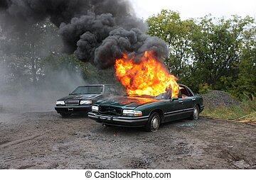 An automobile engulfed in fire. - Fire Department, on the...