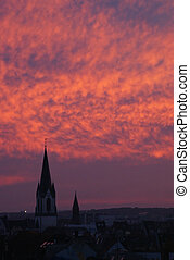 Sundown with church - A red sky with clouds an a chruch in...