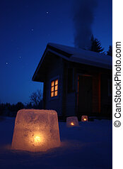 Winter night cabin - Log cabin in winter night with ice...