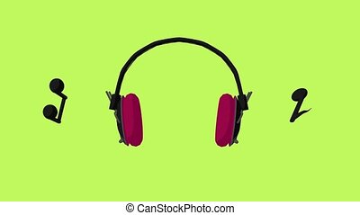 Music notes and headphones on a green background