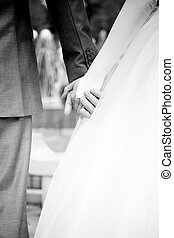 marriage - image of the bride and groom holding hands