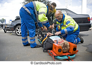 EMS team at work - A team of emergency medical services at...