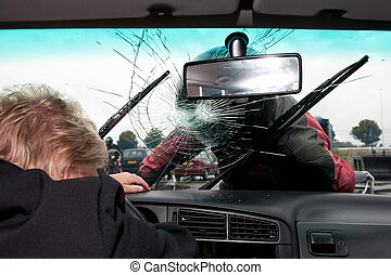 Broken windscreen - Motorist smashes the windscreen of a car...