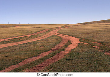 endless roads - Shot of the crossroad at the desert steppe