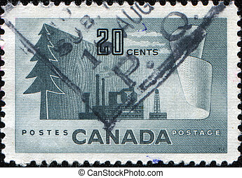 Pulp and Paper Industry - CANADA - CIRCA 1952: A stamp...
