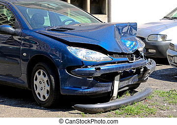 Traffic accident - Small blue car smashed in traffic...