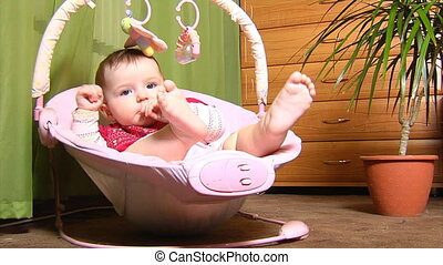 baby n cradle - small baby sitting in bouncer cradle