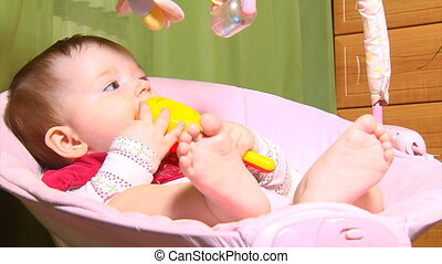 baby in cradle - small baby sitting in bouncer cradle