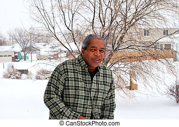 Winter snow. - African american male outside in the winter...