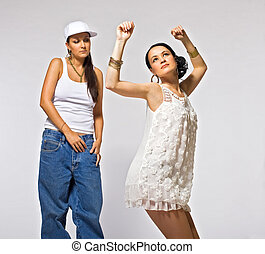 Two young woman dance