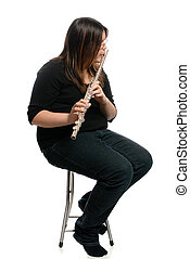 Flute Player - A teenage girl is sitting on a stool while...