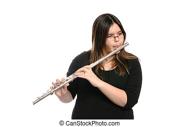 Teenager Playing Flute - A teenage girl is playing the...