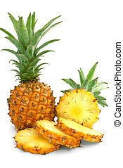 Mini pineapples - Whole and slice mini pineapples on a white...