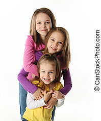 Three young sisters having fun
