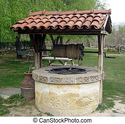 old well in a medieval village in the Tuscan countryside