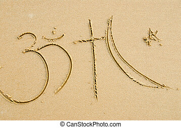 Religous symbols written on the sand