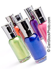 Nail polish bottles placed in front of a white background.