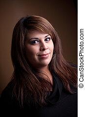 Beautiful Smiling Woman - A beautiful young Hispanic woman...