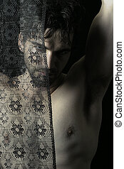 Shirtless man behind black lace - Portrait of beautiful...