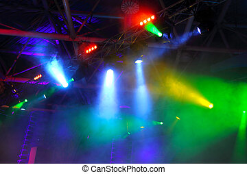 colored spotlights on ceiling in smoke - lighting equipment...