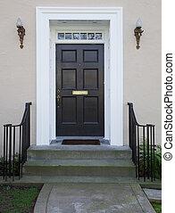Black door angel lights - White wood bordered black door of...