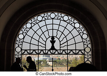 Jerusalem, photographed through a stained-glass window, and...