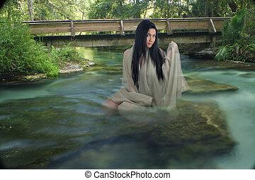 Beautiful Teen in a Creek