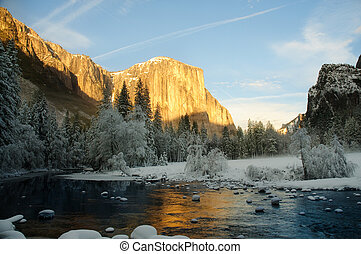 yosemite in winter - Yosemite valley at sunset with golden...