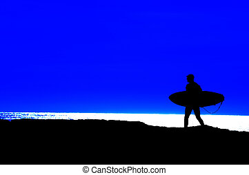 Surfer going out to sea - surfer heading out for a final run...
