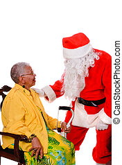 Santa and senior citizen - Santa talking to an African...