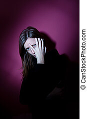 Young woman suffering from a severe depression
