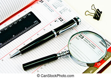 Pen and Agenda with a tools of punctuality - Pen and Agenda...