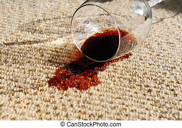 Spilled Wine on Carpet - A glass of red wine, spilt on a...