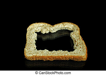 Bread Crust - Bread crust on a black mirror.