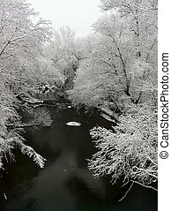 Creek in Winter Snow Scene - A winter landscape show snow...
