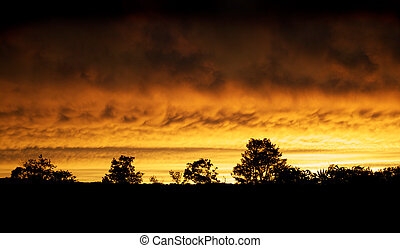 Fire in the Sky - The sky glows fire red after a...