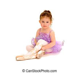 Tiny Ballerina - A tiny ballerina tries on pointe shoes.