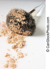Brush with powder - Makeup brush with loose powder close-up...