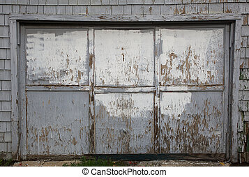 Old worn out gray garage door - Old weathered and worn out...